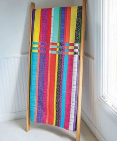 This strip quilt is a quick and easy modern quilt project that's hard to resist.