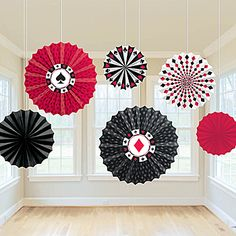 Our Casino Paper Fan Decorations feature various casino themed designs in the colors of black, red and white. These casino paper fans are sold in a set of 6.