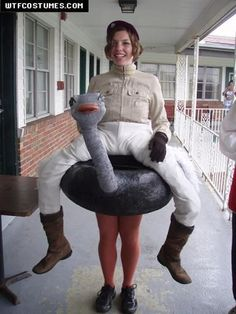 SO FUNNY Ostrich Jockey Costume - constructed using paper mache, an inner tube pool toy, feathers, paint, a slinky, and a few pairs of tights.