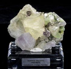 WOW!  4 minerals in 1 specimen:  Quartz, Hematite, Calcite, and Prehnite.