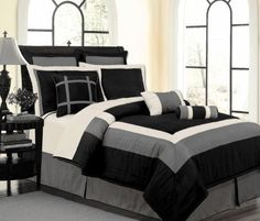 """9 PC LUXURY SET, BLACK / WHITE / GREY HAMPTON FAUX SILK COMFORTER SET - CALIFORNIA CAL KING BEDDING by Grand Linen. $69.95. Set includes, 1 Comforter 101"""" x 86"""", 2 Shams, 1 Bed Skirt, 2 Euro Shams and 3 Dec Pillows. Add Taste, Style & Comfort with this Luxury 9 Pc Patchwork Design To Your Bedroom.. Fabric Content: 100 % Polyester. Thread count: 350. Bring a touch of class into your Bedroom with this Luxurious, 9 Piece Bold patchwork Design Bedding Set. This bed in a ..."""