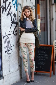 Floral pants and leather jacket paired with pointed pumps. Via Stockholm StreetStyle