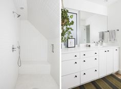 The master bedroom has a large white tiled shower and white cabinets, there is a green striped rug and a plant hanging.