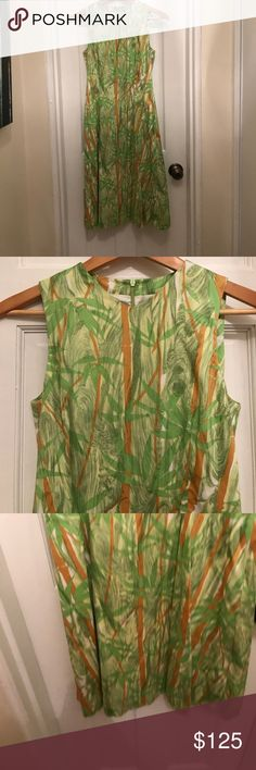 Barneys New York Palm Tree A line Dress Barneys New York Palm Tree Dress- fun, flirty Print palm tree design dress- greens- yellow, white and brown hues throughout- darting on the sides and down the front- more flowy skirt- EUC- worn on one occasion Barneys New York Dresses