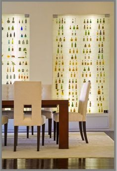 A designer created this wall to house her client's miniature alcohol bottle collection from around the world.
