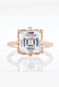 "Brides.com: . ""Ellen"" rose gold pavé ring featuring 3.11 carat center diamond with 0.55 carats of surrounding diamonds, price upon request, Erica Courtney"