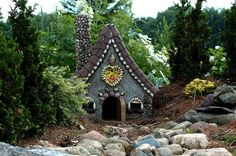Fairy house    One of the fairy houses in the Discovery Garden, Colvil Park Red Wing, MN The gardens were built for adults and children to touch, smell, feel, learn, enjoy! One of the raised beds is a fairy garden complete with houses for them to reside in