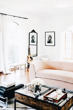 pink sofa + black and white accents