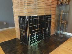 """This particular screen is hinged on the short """"return"""" side for easy access into the firebox. The screen can also be made to fit a single sided fireplace, as well as be done in other designs. Please visit our local showroom for more details www.wilshirefireplace.com"""