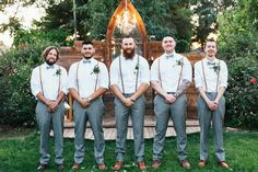 Unique + boho groomsmen outfit idea - white button-downs, gray slacks, light blue bow ties and suspenders  {Suzy Goodrick Photography}
