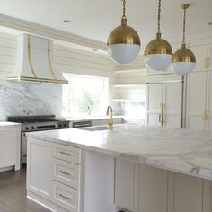 Consider a stain grade wood detail to add warmth to what will be an overall white kitchen. Then fabricate the brass strapping detail. Gray And White Kitchen, Gold Kitchen, Home Decor Kitchen, Kitchen Interior, New Kitchen, Home Kitchens, Kitchen Ideas, French Kitchen, Small Kitchens