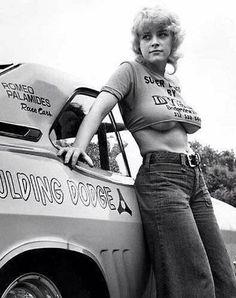 Racing cars and glamorous women!