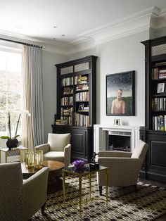 The dark bookshelves creates great depth to the neutral pallet.
