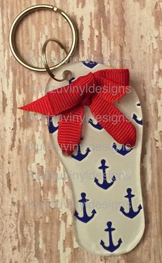 "3"" Acrylic Flip Flop keychain with blue anchor pattern and white background and a red ribbon. $8.00 each plus shipping if needed."
