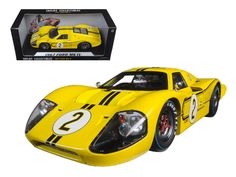 1967 Ford GT MK IV #2 Yellow LeMans 24 Hours Mark Donohue / B.Mclane 1/18 Diecast Model Car by Shelby Collectibles - Brand new 1:18 scale diecast car model of 1967 Ford GT MK IV #2 Yellow LeMans 24 Hours Mark Donohue / B.Mclane die cast car by Shelby Collectibles. Brand new box. Rubber tires. Has steerable wheels. Has opening hood, doors and trunk. Made of diecast with some plastic parts. Detailed interior, exterior, engine compartment. Dimensions approximately L-10, W-4, H-3 inches. Please…