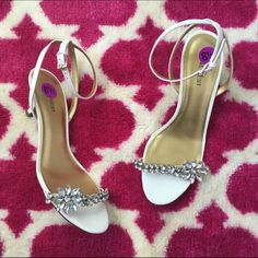 Rhinestone Sandals NWOT. Gorgeous rhinestones. Ankle straps. Small heel. This pair of shoes has it all! Never worn and true to size. Nine West Shoes Sandals