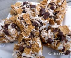 s'more krispy treats    1/4 cup butter  1 (10 oz) bag regular marshmallows  1 box of Golden Graham cereal  1-2 cups Chocolate Chips    In a large sauce pan, melt butter over medium heat.  Add marshmallows and keep stirring until the marshmallows completely melt and you get a marshmallow sauce.  Remove from heat.    Add Golden Grahams and stir until