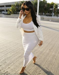 The tighter the better: The reality star wore a white crop top and pencil skirt which clung to her famous figure
