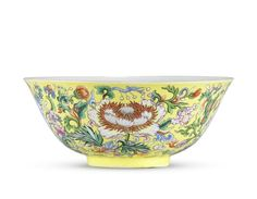 An exceptionally rare Imperial famille rose yellow-ground 'floral' bowl, Qianlong six-character mark and of the period (1736-1795)