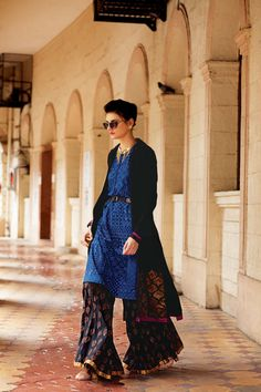 Layer these traditional separates for a look that's refreshing and chic. A long collared woolen jacket with brocade patchwork worn over an indigo printed kurta and complimenting pallazzos, gives you a look that's relaxed, ultra stylish and straight off the ramp.