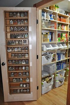 Spice rack on the door- with an attached walk in pantry!