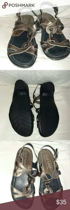 Cute low heal metallic silver leather sandal. Cute, comfy dress sandal. Metallic silvery (slightly taupey) leather. Low 1 inch slight heel. Never worn. Josef Seibel Shoes Sandals