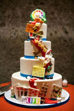 Board Game Wedding Cake | Suzy Berberian Weddings And Events https://www.theknot.com/marketplace/suzy-berberian-weddings-and-events-petaluma-ca-413628 | Calistoga Ranch - An Auberge Resort https://www.theknot.com/marketplace/calistoga-ranch-an-auberge-resort-calistoga-ca-370828 | Inticing Creations https://www.theknot.com/marketplace/inticing-creations-san-francisco-ca-334519