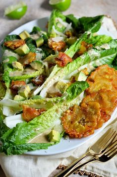 Cuban Caesar Salad. This twist on the classic Caesar features tostones, avocado, manchego cheese, and a zesty dressing that I can't get enough of.   hostthetoast.com