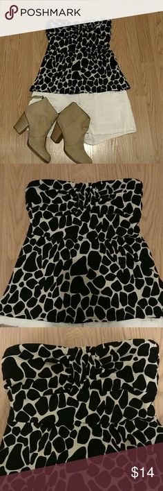 **FEBRUARY SALE!** Sexy MetroPark Tubetop Super sexy giraffe print MetroPark tube top. This top is fantastic because it can be worn with shorts and sandals or dressed up with a mini-skirt and heels. The top is tight around the bust and looser under the busy for a perfect fit! Metropark Tops
