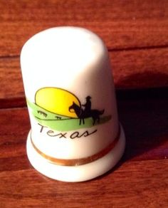 Texas porcelain thimble. This would be cute tucked on a little shelf.
