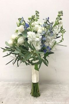 Blue and white wedding bouquets. Wedding Flowers Liverpool, Merseyside, Bridal Florist, Booker Flowers and Gifts, Booker Weddings