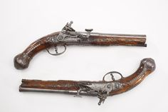 "Cassiano Zanotti Snaphaunce Pistol Pair - This .60 caliber pair incorporated the snaphaunce firing mechanism, the earliest form of the flintlock. These pistols, which include decorative metal inlays & wood carvings, were typical arms produced in the region between Florence & Bologna during the late 18th & early 19th centuries.  Dated from 1782, the pistols bear the initials ""C.Z."" on the inside of the lockplate. They are attributed to Cassiano Zanotti, the son of a gunsmithing family."