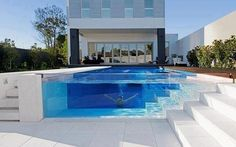 Glass sided swimming pool
