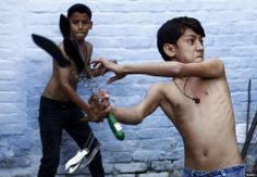 Shia boys begin to flagellate themselves during a Muharram procession ahead of Ashura in Amroha, India  http://earth66.com/human/shia-boys-begin-flagellate-muharram-procession-ahead-ashura-amroha-india/