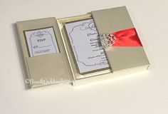 Valentine's Day wedding coming up? Ivory silk gatefold for your dream wedding. Surprise your guests with luxury wedding invitations. Red satin ribbon and a beautiful crystal clasp for an exquisite look✨  See more at www.boxedweddinginvitations.com  #wedding #weddings #invitation #gatefold #stationery #boxedinvitation