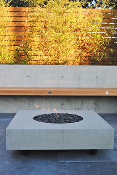Botanica Design | Our Work custom firebowl, bamboo screen and cedar bench with concrete back