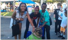 Coco with new friends at the 2015 Margate National Night out. As a therapy dog she is volunteering her services to the Margate CERT team.