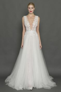 This gauzy plunging Francesca Miranda dress with a smattering of butterflies. | 27 Ridiculously Pretty Wedding Dresses To Look At While The World Burns