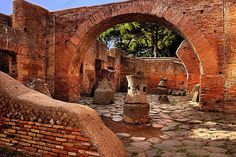 Ostia Antica, this is where a lot of the bread for Ostia was made, each of those stones ground the gain when an animal (donkey maybe) was attached to a wooden beam put through the top :)