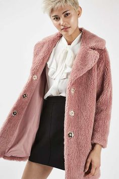Wrap up in style with this trophy faux fur jacket with collar detail and three popper front fastenings. In an eye-catching pink, we've styled with a frill shirt and mini skirt for an overall chic look. #Topshop