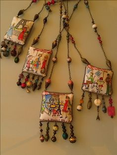 DELOLA - sew  painted fabric to chains and decorate with found objects