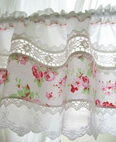 Sew a strip of bold fabric with lace-curtains