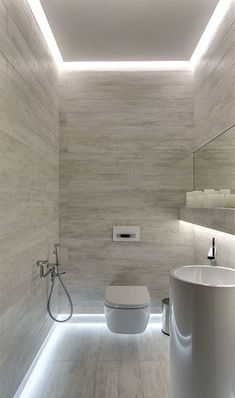 Image 6 of 15 from gallery of Smart Hidden Lighting Ideas For Dramatic Touch. Stunning small bathroom with hidden lighting fixtures on ceiling and floor wall border