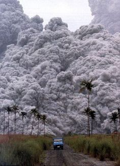 A volcano's deadly pyroclastic flow - the same thing that buried Pompeii. You can't outrun it: it travels at 700 km/h (450 mph) and you can't weather it in anything but highly specialized shelters: it's over 1,000 °C (1,830 °F). Once you see that in your rear view mirror, you're either already out of reach or you're not.