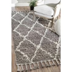 A best selling style with an easy pattern and plush texture.  Gorgeous gray and cream create the perfect pairing for your bedroom or living room style. #shag #fringebenefits #gray