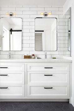 Clean white bath with black hex floor tiles and marble counters.