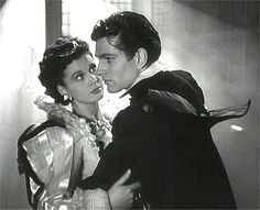 Screenshot from the film ''Fire Over England'' (1937) showing actors Vivien Leigh and Laurence Olivier.