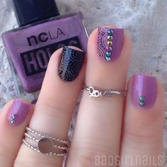 Tribal inspired nail art in black and thistle polish combined with silver dust and beads for a more mystifying effect