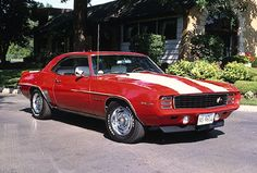 http://musclecars.howstuffworks.com/classic-muscle-cars/1969-chevy-camaro-z28.htm  Although this car actually came out in '69. The '69 Camaro is a great example of 70's cars. It is by far the most famous muscle car ever in production, and revolutionized the way people thought about muscle cars.  --MMG