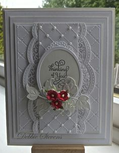 Another Debbie Stevens...Spellbinders Grand rectangles, Spellbinders A2 scalloped borders, Spellbinder classic ovals large, marianne designs (leaf) justrite hugs and kisses stamp, Sue Wilson heart lattice embossing folder, flowers from Wild orchid crafts.